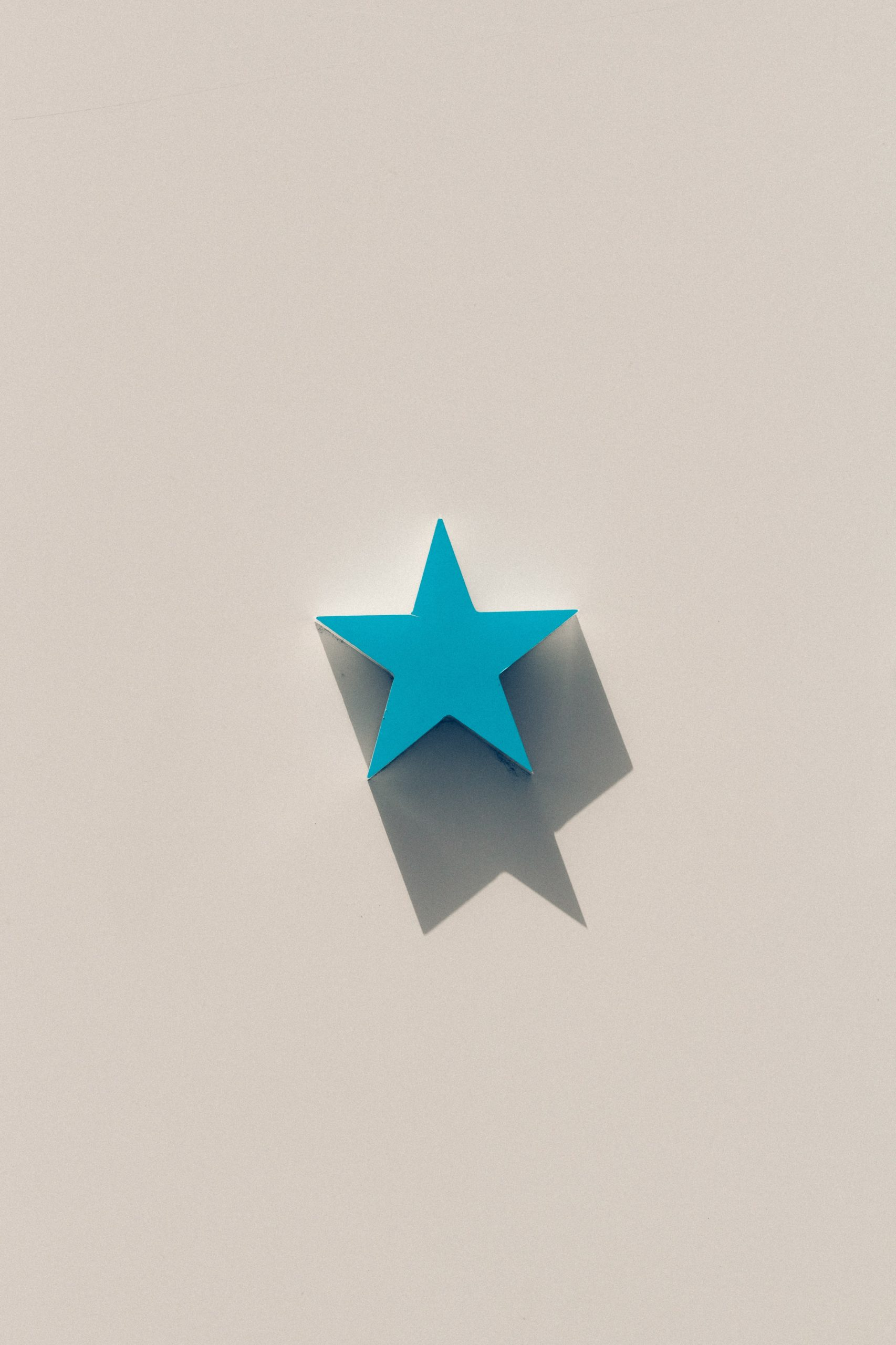 Wooden blue star on a stark background