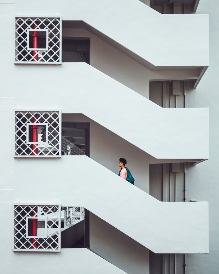 Man walking up a set of repetitive stairs